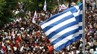 Group of protesters hold giant Greek flag Photo: REUTERS/John Kolesidis