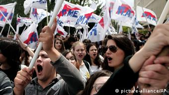 Protesters chant slogans outside the Greek state television ERT headquarters (AP Photo/Petros Giannakouris)