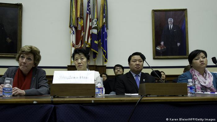 Songhwa Han(2L), former North Korean refugee detained in China, repatriated to North Korea, and detained in North Korea and Jinhye Jo(R), Former North Korean refugee detained in China, repatriated to North Korea, and detained in North Korea testify March 5, 2012 before the US House Foreign Affairs Committee Congressional Executive Commission on China on Capitol Hill In Washington, DC. The committee held hearings on China's Repatriation of North Korean Refugees. Looking on are: Suzanne Scholte, President, Defense Forum Foundation; Chairman and Founding Member of the North Korea Freedom Coalition and an unidentified interpreter. AFP PHOTO/Karen BLEIER (Photo credit should read KAREN BLEIER/AFP/Getty Images)
