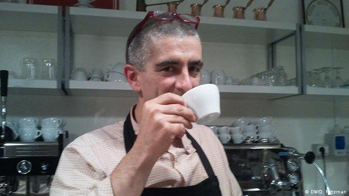 Bar owner Manuel Terzi with a cup of coffee in front of his espresso machine in his cafe in Bologna, May 2013 Photo: Dany Mitzman