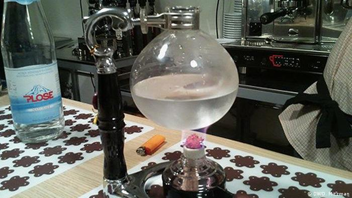 Water being boiled on a tiled surface in the Terzi cafe's coffee lab