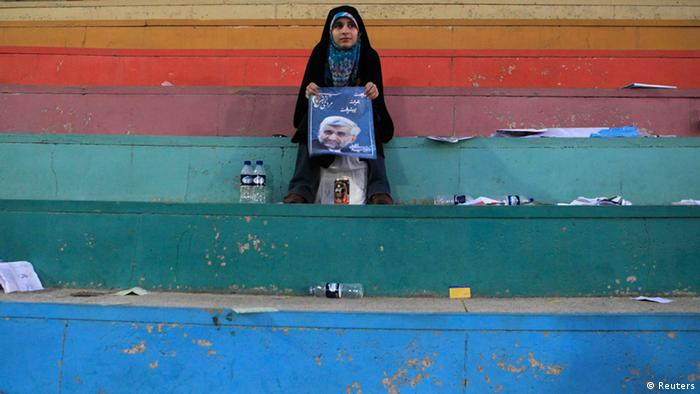 A supporter of Iranian presidential candidate Saeed Jalili holds his picture after a rally in Tehran June 12, 2013. Picture taken June 12, 2013. REUTERS/Yalda Moayeri (IRAN - Tags: POLITICS ELECTIONS TPX IMAGES OF THE DAY)