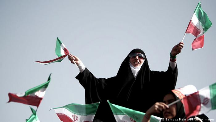 Iranian supporters of top nuclear negotiator and conservative presidential candidate, Saeed Jalili, wave the national flags during his campaign rally at Heydarnia stadium in downtown Tehran on June 12, 2013. Iran's six presidential hopefuls took part in last-ditch election campaigning, hoping to woo the millions of Iranians still undecided between a slew of conservatives and a moderate cleric backed by reformists. AFP PHOTO/BEHROUZ MEHRI (Photo credit should read BEHROUZ MEHRI/AFP/Getty Images)