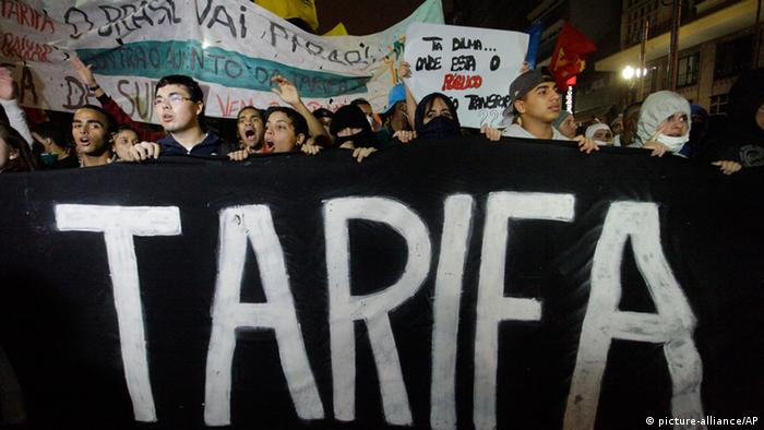Demonstrators shout slogans as they protest an increase in the cost of public transportation in Sao Paulo, Brazil, Thursday, June 13, 2013. (AP Photo/Nelson Antoine)