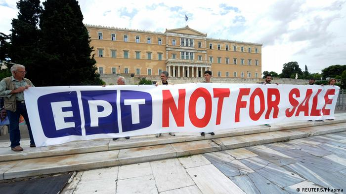 Protesters hold a banner in front of the parliament in Athens June 14, 2013.REUTERS/Phasma/Giorgos Nikolaidis