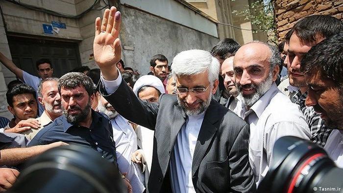 سعید تاجیک (نفر سمت چپ)، هتاک خانواده هاشمی رفسنجانی در همراهی با سعید جلیلی، کاندیدای ریاستجمهوری