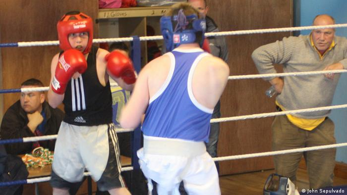 Two Irish Traveller boys fight in a boxing ring in Tuam, Western Ireland