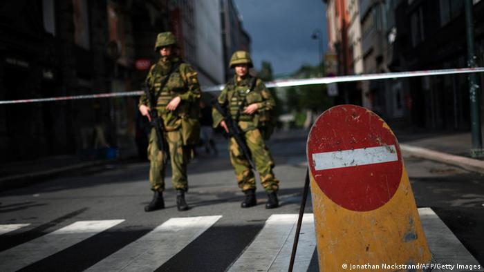 Norwegian soldiers stands guard a few blocks from the government headquarters (photo via Getty Images)