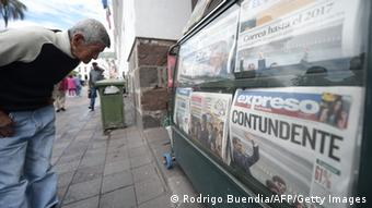 A man reads the front pages of newspapers a day after Ecuadorean President Rafael Correa was reelected (c) RODRIGO BUENDIA/AFP/Getty Images