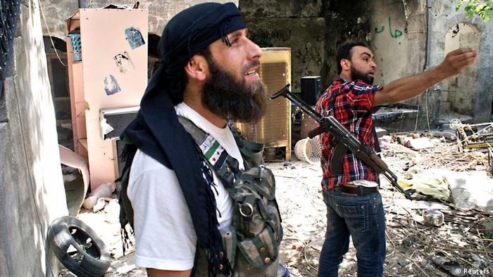 A Free Syrian Army fighter gestures as his comrade looks on in the old city of Aleppo, June 13, 2013. Picture taken June 13, 2013. REUTERS/Jalal al-Halabi/Shaam News Network/Handout