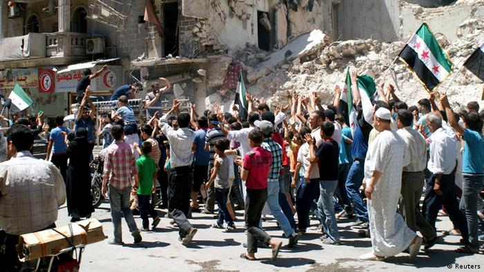 Civilians and Free Syrian Army fighters carry Syrian opposition flags and chant slogans as they walk past damaged buildings during a protest against Syria's President Bashar al-Assad, in Aleppo, June 14, 2013. REUTERS/Jalal al-Halabi/Shaam News Network/Handout via Reuters (SYRIA - Tags: POLITICS CIVIL UNREST CONFLICT) ATTENTION EDITORS - THIS PICTURE WAS PROVIDED BY A THIRD PARTY. REUTERS IS UNABLE TO INDEPENDENTLY VERIFY THE AUTHENTICITY, CONTENT, LOCATION OR DATE OF THIS IMAGE. FOR EDITORIAL USE ONLY. NOT FOR SALE FOR MARKETING OR ADVERTISING CAMPAIGNS. NO SALES. NO ARCHIVES. THIS PICTURE IS DISTRIBUTED EXACTLY AS RECEIVED BY REUTERS, AS A SERVICE TO CLIENTS