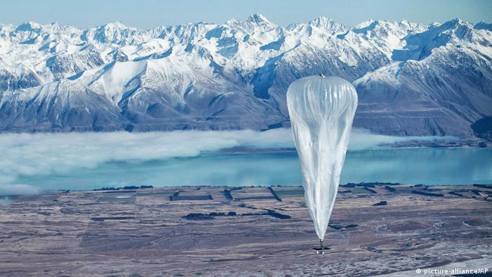 In this June 10, 2013 photo released by Jon Shenk, a Google balloon sails through the air with the Southern Alps mountains in the background, in Tekapo, New Zealand. Google is testing the balloons which sail in the stratosphere and beam the Internet to Earth. (AP Photo/Jon Shenk) EDITORIAL USE ONLY