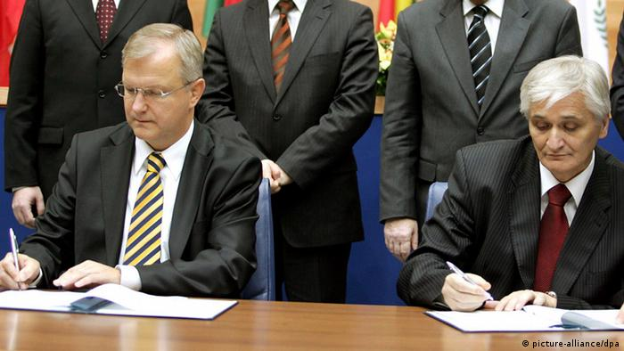EU Enlargement Commissioner Olli Rehn,left, with the Chairman of Bosnia-Herzegovina's central government, Nikola Spiric, right, initials the Stabilisation and Association Agreement (SAA) between Bosnia-Herzegovina and the EU, in Sarajevo on Tuesday, Dec. 4, 2007. Initialing of the rapprochement deal between Bosnia and the EU comes as the first step towards the country's eventual full EU membership. At rear are EU High Representative Miroslav Lajcak, left, and all three members of the Bosnian Presidency witness the signing Zeljko Komsic, second left, Haris Silajdzic, second right and Nebojsa Radmanovic, right. (AP Photo/Hidajet Delic)
