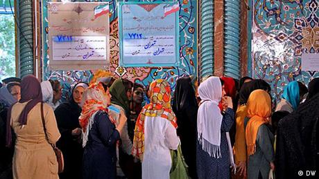 Women line up to vote at a polling place in Iran, June 2014.