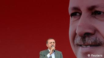 Turkey's Prime Minister Tayyip Erdogan addresses his supporters during a rally organized by his Justice and Development Party in Ankara June 15, 2013. Erdogan warned protesters occupying a central Istanbul park that they should leave before a ruling party rally on Sunday or face eviction by the security forces. REUTERS/Stringer (TURKEY - Tags: POLITICS CIVIL UNREST)