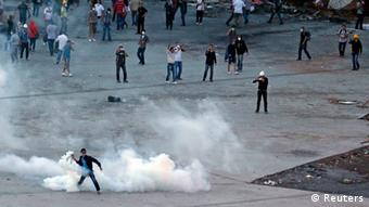 A protester throws a teargas canister back at riot police in front of Gezi Park at Taksim Square in Istanbul June 15, 2013. Turkish riot police stormed Gezi Park on Saturday firing tear gas and water cannon to evict hundreds of anti-government protesters, hours after an ultimatum from Prime Minister Tayyip Erdogan. REUTERS/Osman Orsal (TURKEY - Tags: POLITICS CIVIL UNREST)