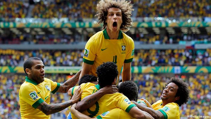 BRASILIA, BRAZIL - JUNE 15: David Luiz of Brazil celebrates after Neymar scored his team's opening goal during the FIFA Confederations Cup Brazil 2013 Group A match between Brazil and Japan at National Stadium on June 15, 2013 in Brasilia, Brazil. (Photo by Dean Mouhtaropoulos/Getty Images)