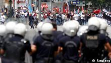 Protesters are confronted by police during a demonstration at Kizilay square in central Ankara June 16, 2013. Thousands of people took to the streets of Istanbul overnight on Sunday, erecting barricades and starting bonfires, after riot police firing teargas and water cannon stormed a park at the centre of two weeks of anti-government unrest. Lines of police backed by armoured vehicles sealed off Taksim Square in the centre of the city as officers raided the adjoining Gezi Park late on Saturday, where protesters had been camped in a ramshackle settlement of tents. REUTERS/Dado Ruvic (TURKEY - Tags: CIVIL UNREST POLITICS)