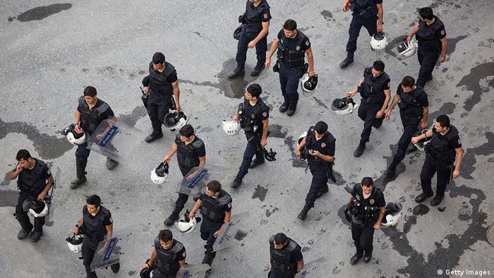 Aerial view of riot police walking past Taksim Square after the crackdown action on June 16, 2013 in Istanbul, Turkey. (Photo by Lam Yik Fei/Getty Images)