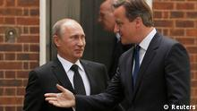 Britain's Prime Minister David Cameron (R) greets Russia's President Vladimir Putin in Downing Street, in central London June 16, 2013. The two leaders will meet ahead of the G8 summit in Northern Ireland, amid local media speculation that they will discuss the crisis in Syria. REUTERS/Luke MacGregor (BRITAIN - Tags: POLITICS)