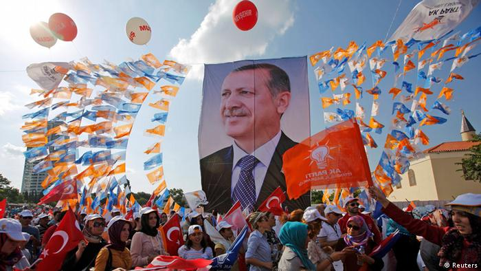 Supporters hold a poster of Turkish Prime Minister Tayyip Erdogan during a rally of ruling AK party in Istanbul June 16, 2013. (Photo: REUTERS/Murad Sezer)