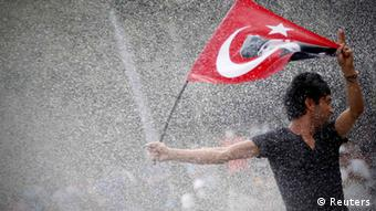 Anti-government protesters shout slogans as they stand on barricades in Istanbul June 16, 2013. Turkish Prime Minister Tayyip Erdogan rallied hundreds of thousands of supporters at an Istanbul parade ground on Sunday as riot police fired teargas a few kilometres away in the city centre to disperse anti-government protesters. Riot police fired teargas into side streets around the central Taksim Square as he spoke, trying to prevent protesters from regrouping after hundreds were evicted from the adjoining Gezi Park, the centre of the demonstrations, late on Saturday. REUTERS/Serkan Senturk (TURKEY - Tags: POLITICS CIVIL UNREST TPX IMAGES OF THE DAY)