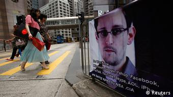 A poster supporting Edward Snowden, a former contractor at the National Security Agency (NSA) who leaked revelations of U.S. electronic surveillance, is displayed at Hong Kong's financial Central district June 17, 2013. Snowden reportedly flew to Hong Kong on May 20. He checked out of a luxury hotel on June 10 and his whereabouts remain unknown. Snowden has said he intends to stay in Hong Kong to fight any potential U.S. moves to extradite him. REUTERS/Bobby Yip (CHINA - Tags: POLITICS CRIME LAW SCIENCE TECHNOLOGY)