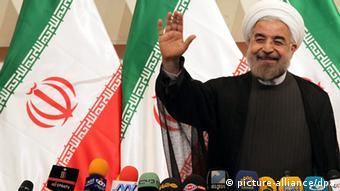 Iranian President-elect Hassan Rowhani greets media during a press conference in Tehran, Iran, 17 June 2013. President-elect Rowhani said on 17 June that Iran would be ready to reduce tensions with arch-enemy United States based on goodwill and mutual respect. 'With the US we have an old wound but we are still ready to look into the future and reduce tensions, but on the basis of goodwill and mutual respect,' Rowhani said. On the topic of Syria he said that Iran would continue supporting the government of Syrian President Bashar al-Assad until an election in 2014. EPA/ABEDIN TAHERKENAREH