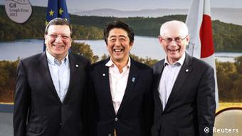 European Commission President Jose Manuel Barroso (L) and European Council President Herman Van Rompuy (R) hold a meeting with Japan's Prime Minister Shinzo Abe at a G8 summit in Enniskillen, Northern Ireland June 17, 2013.