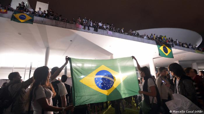 Protesters with Brazilian flag 