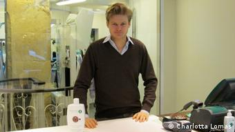 Who is the photographer: Charlotta Lomas When was the picture taken: 25/02/2013 Where was the picture taken: Sequoia dry-cleaning store in Paris. Description: Photograph of Sequoia shop in Paris. Sequoia founder Nicolas de Bronac serves a customer.