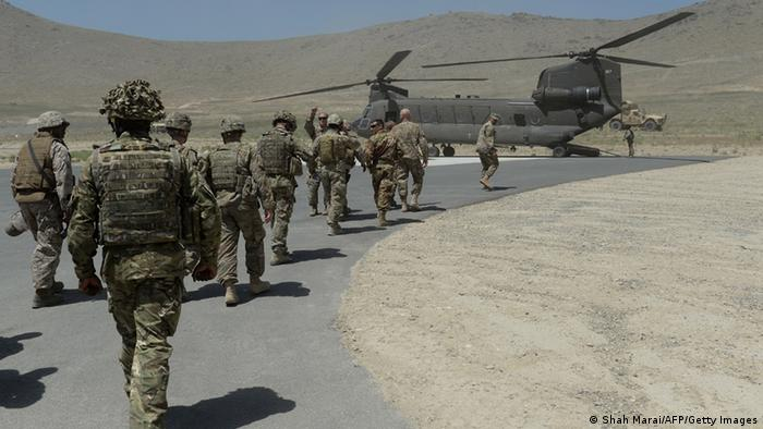 NATO soldiers board a Chinook helicopter after a security handover ceremony at a military academy outside Kabul on June 18, 2013. (Photo: AFP)