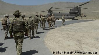 NATO soldiers board a Chinook helicopter outside Kabul on June 18, 2013.