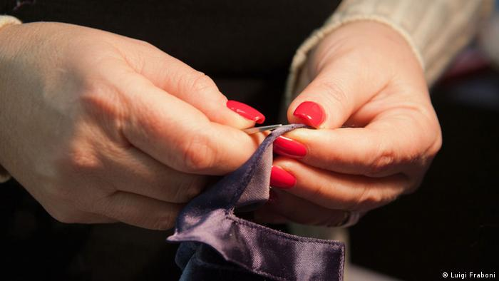 The hands of Italian tailor Paola Gueli transform garments with a finesse that's impossible to achieve with the most sophisticated sewing machines. (photo by Luigi Fraboni)