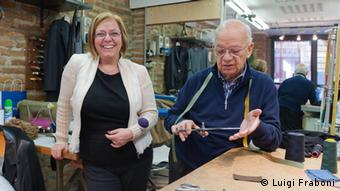 Tailors Paola and Raffaele Gueli, daughter and father, have about a century of combined experience. Today one in five tailoring jobs goes unfilled, despite record unemployment. (Photo by Luigi Fraboni, DW Correspondent, Italy)