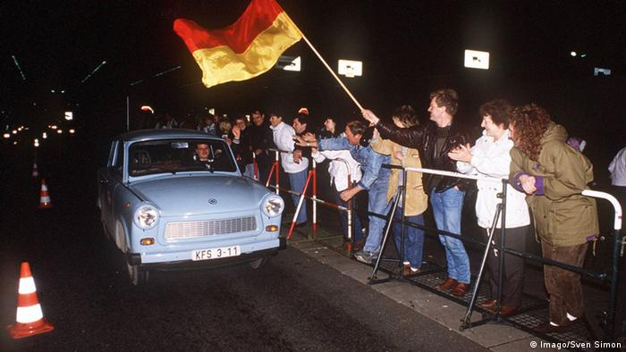 A Trabi rolls across the East-West German borders when the Berlin Wall came down in 1989.