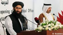 Muhammad Naeem (L), a spokesman for the Office of the Taliban of Afghanistan speaks during the opening of the Taliban Afghanistan Political Office in Doha June 18, 2013. The Afghan Taliban opened an office in Qatar on Tuesday to help restart talks on ending the 12-year-old war, saying it wanted a political solution that would bring about a just government and end foreign occupation. Taliban representative Mohammed Naeem told a news conference at the office in the capital Doha that the Islamist insurgency wanted good relations with Afghanistan's neighbouring countries. REUTERS/Mohammed Dabbous (QATAR - Tags: POLITICS)