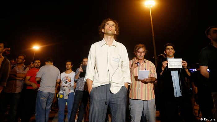 Erdem Gunduz (C) stands in a silent protest at Taksim Square in Istanbul early June 18, 2013. (REUTERS/Marko Djurica)