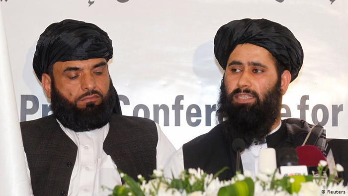 Muhammad Naeem (R), a spokesman for the Office of the Taliban of Afghanistan speaks during the opening of the Taliban Afghanistan Political Office in Doha June 18, 2013. The Afghan Taliban opened the office in Qatar on Tuesday to help restart talks on ending the 12-year-old war, saying it wanted a political solution that would bring about a just government and end foreign occupation. Taliban representative Naeem told a news conference at the office in the capital Doha that the Islamist insurgency wanted good relations with Afghanistan's neighbouring countries. REUTERS/Mohammed Dabbous (QATAR - Tags: POLITICS)