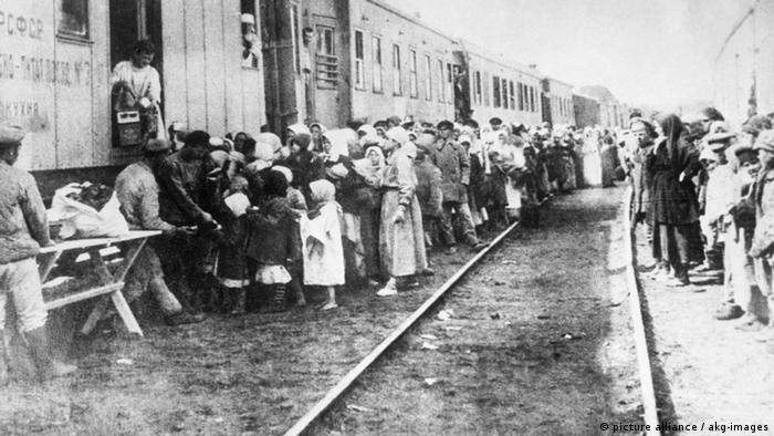 Old photo of Volga Germans gathering at trains