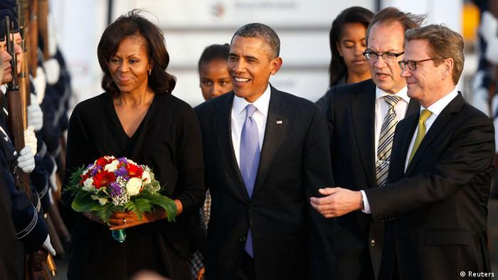 U.S. President Barack Obama and his wife Michelle (L) are introduced to dignataries by German Foreign Minister Guido Westerwelle (R) upon arrival at Tegel airport in Berlin June 18, 2013. Obama's first presidential visit to Berlin comes nearly 50 years to the day after John F. Kennedy landed in a divided Berlin at the height of the Cold War and told encircled westerners in the city Ich bin ein Berliner, a powerful signal that America would stand by them. At right is German Foreign Minister Guido Westerwelle. REUTERS/Wolfgang Rattay (GERMANY - Tags: POLITICS)