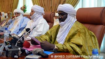 A member of the Tuareg delegation takes part in a meeting on the Malian crisis on June 18, 2013 in Ouagadougou. The Malian government and Tuareg rebels occupying a key northern city signed an accord today paving the way for presidential elections in the west African state next month. Mali's territorial administration minister and representatives of two Tuareg movements signed the deal in Ouagadougou, capital of neighbouring Burkina Faso, as the lead mediator in negotiations, Burkinabe President Blaise Compaore, looked on. AFP PHOTO AHMED OUOBA (Photo credit should read AHMED OUOBA/AFP/Getty Images)
