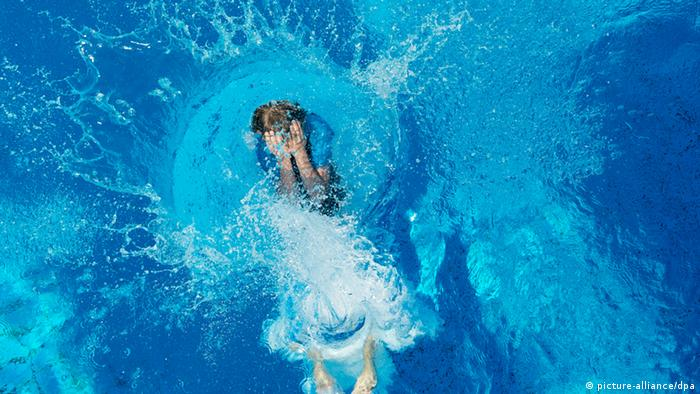 A boy submerged in a swimming pool