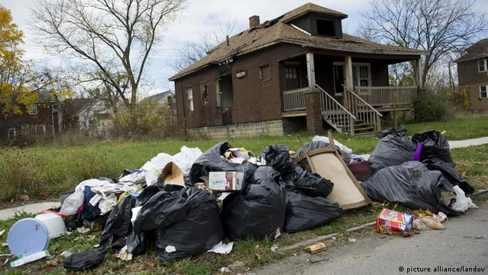 Pile of garbage in front of dilapidated house in Detroit (UPI/Kevin Dietsch /LANDOV)