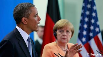 U.S. President Barack Obama speaks next to German Chancellor Angela Merkel during a news conference after their meeting at the Chancellery in Berlin, June 19, 2013. Obama will use a speech on Wednesday to revive proposals for a world without nuclear arms by targeting cuts in deployed nuclear weapons of up to a third below levels achieved in a 2010 treaty with Russia, a senior U.S. official said. In Berlin, where John F. Kennedy and Ronald Reagan gave Cold War speeches denouncing the division of the city, he will try to move beyond the New START treaty that required the United States and Russia to cut stockpiles of deployed nuclear weapons to 1,550 each by 2018. REUTERS/Thomas Peter (GERMANY - Tags: POLITICS)