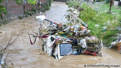 Trash covers a truck submerged in flood waters from heavy monsoon rains in Dehradun in the Indian state of Uttrakhand on June 17, 2013. (Photo: AFP)