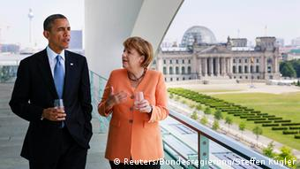 German Chancellor Angela Merkel and U.S. President Barack Obama speak on the terrace of the Chancellery in Berlin, in this June 19, 2013 handout from BPA. REUTERS/Bundesregierung/Steffen Kugler/Handout via Reuters (GERMANY - Tags: POLITICS) ATTENTION EDITORS - NO SALES. NO ARCHIVES. FOR EDITORIAL USE ONLY. NOT FOR SALE FOR MARKETING OR ADVERTISING CAMPAIGNS. THIS IMAGE HAS BEEN SUPPLIED BY A THIRD PARTY. IT IS DISTRIBUTED, EXACTLY AS RECEIVED BY REUTERS, AS A SERVICE TO CLIENTS