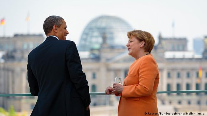 German Chancellor Angela Merkel and U.S. President Barack Obama (L) speak on the terrace of the Chancellery in Berlin, June 19, 2013. REUTERS/Bundesregierung/Steffen Kugler/Handout (GERMANY - Tags: POLITICS) NO SALES. NO ARCHIVES. FOR EDITORIAL USE ONLY. NOT FOR SALE FOR MARKETING OR ADVERTISING CAMPAIGNS. THIS IMAGE HAS BEEN SUPPLIED BY A THIRD PARTY. IT IS DISTRIBUTED, EXACTLY AS RECEIVED BY REUTERS, AS A SERVICE TO CLIENTS