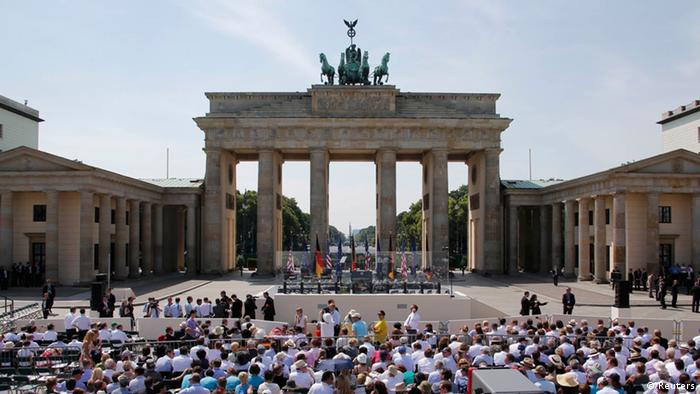 Invited guests await the arrival of U.S. President Barack Obama in front of the Brandenburg Gate