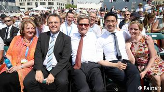 German Justice Minister Sabine Leutheusser-Schnarrenberger (FDP) German Interior Minister Hans-Peter Friedrich (CSU), German Foreign Minister Guido Westerwelle (FDP), German Economy Minister Philipp Roesler (FDP) and his wife Wiebke Roelser (L-R) wait for U.S. President Barack Obama's speech in front of Brandenburg Gate at Pariser Platz in Berlin June 19, 2013. Obama's first presidential visit to Berlin comes nearly 50 years to the day after John F. Kennedy landed in a divided Berlin at the height of the Cold War and told encircled westerners in the city Ich bin ein Berliner, a powerful signal that America would stand by them. REUTERS/Michael Kappeler/Pool (GERMANY - Tags: POLITICS)